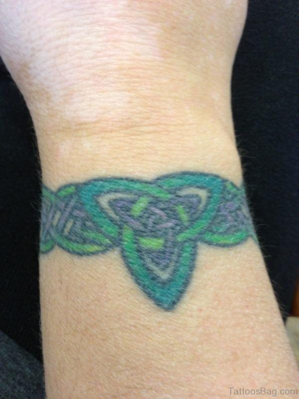 Green Celtic Tattoo On Wrist
