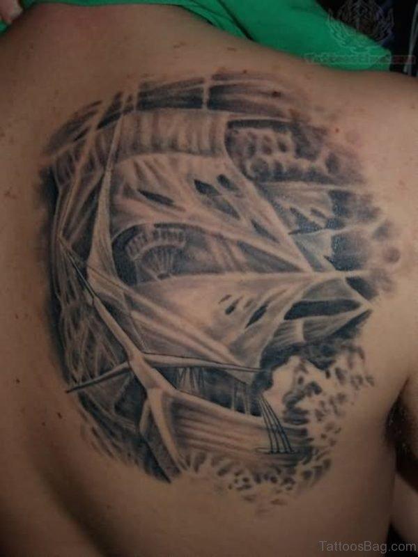 Grey Ink Back Ship Tattoo