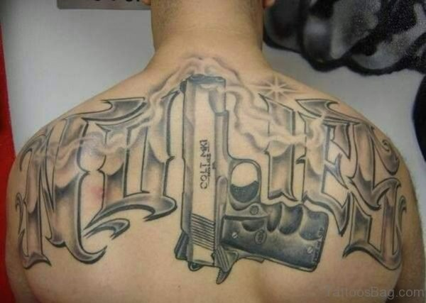 Grey Ink  Gun Tattoo On Upper Back