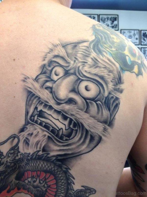 Grey Ink Drama Mask Tattoo On Back