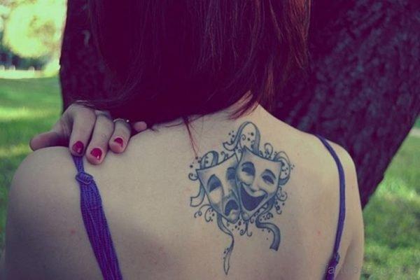 Grey Ink Drama Masks Tattoo On Upper Back