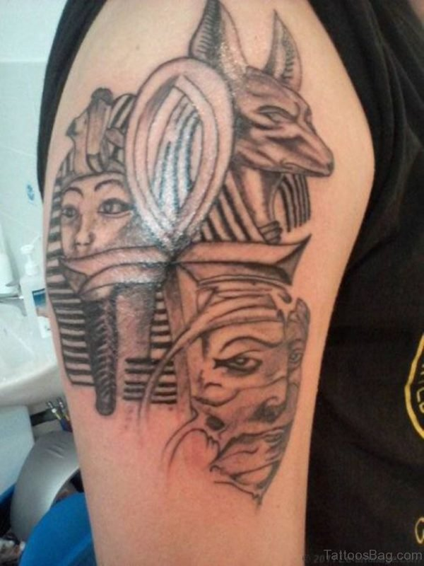 Grey Ink Egyptian Anubis Tattoo On Right Shoulder