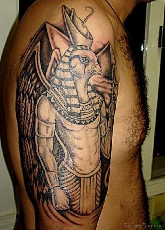Grey Ink Egyptian Tattoo On Shoulder