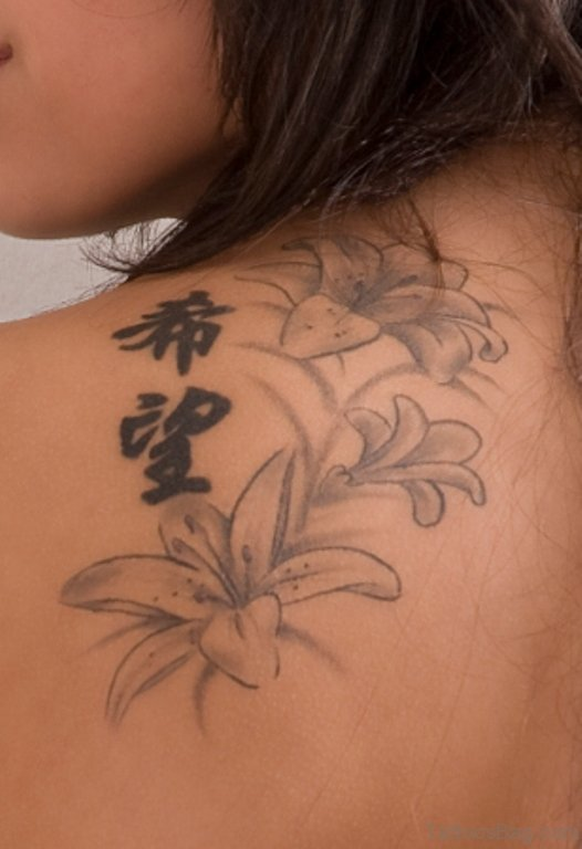 Grey Ink Lily Tattoo