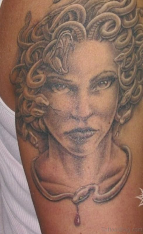 Grey Ink Medusa Face Tattoo On Right Shoulder