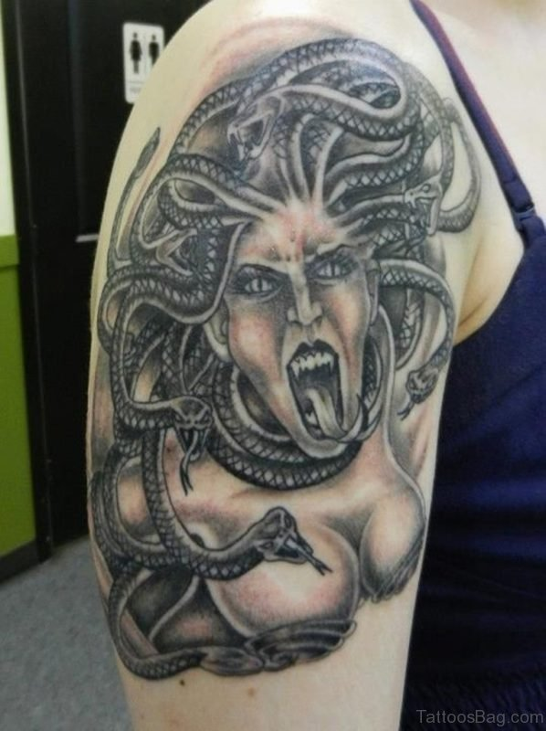 Grey Ink Screaming Medusa Tattoo On Shoulder