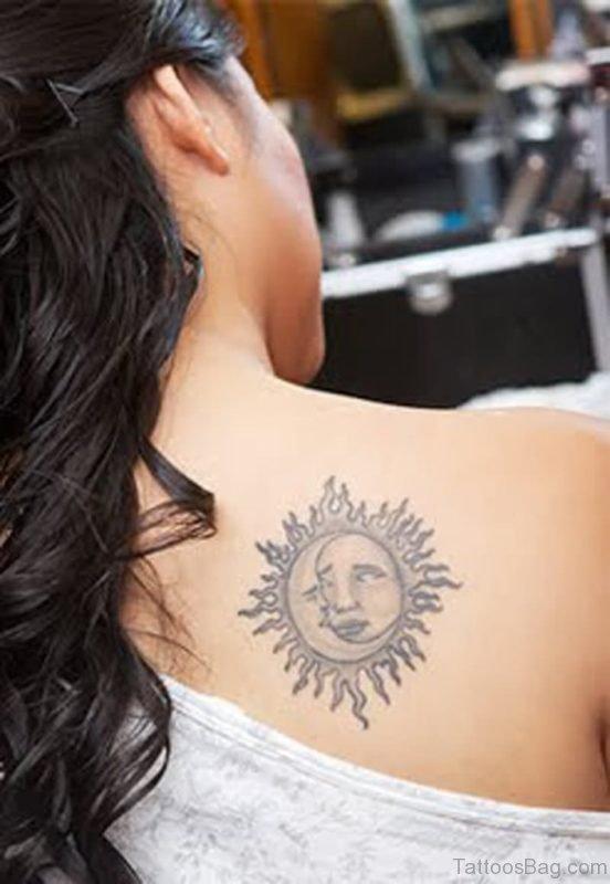 Grey Ink Sun Tattoo On Back