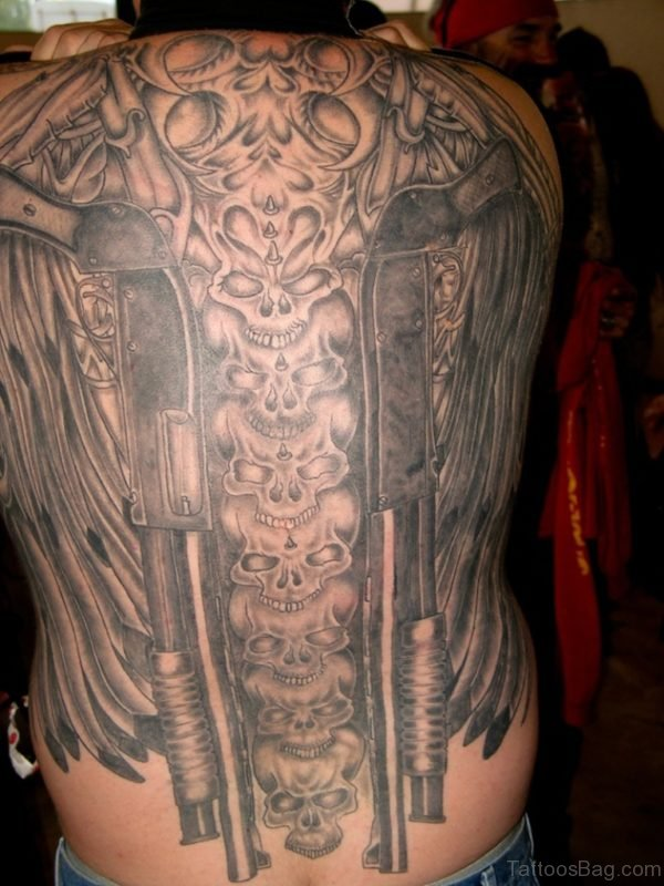Grey Ink Winged Skulls And Guns Tattoo On Back