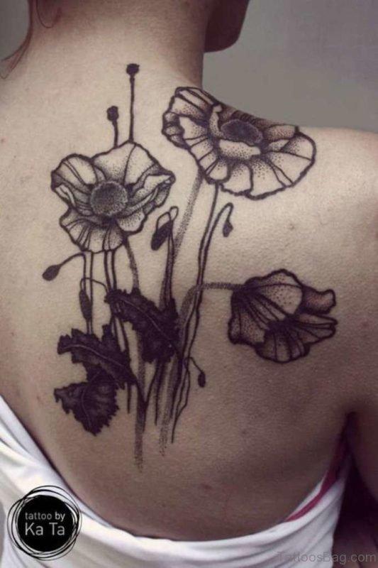 Grey Poppy Tattoo On Back