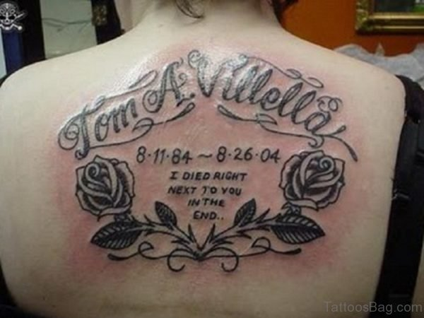Grey Rose And Wording Tattoo