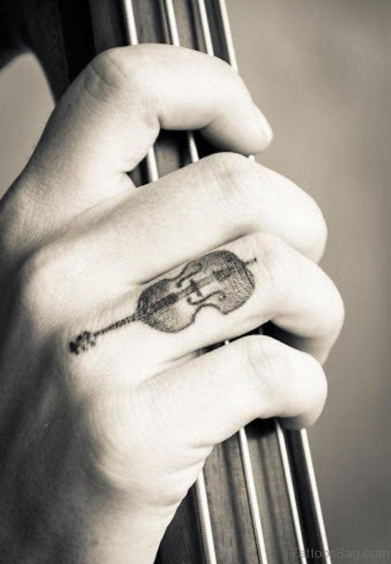 Guitar Tattoo On Finger