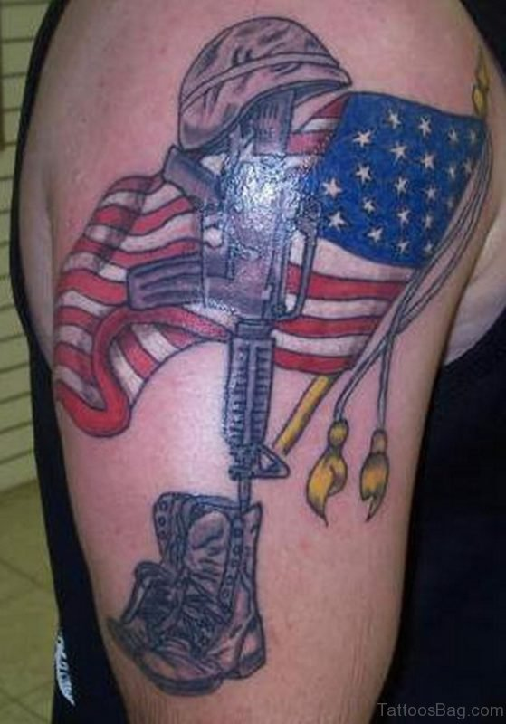 Gun And American Flag Tattoo On Shoulder