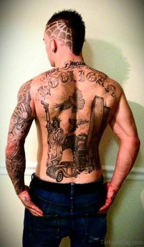 Gun And Car Tattoo On Back