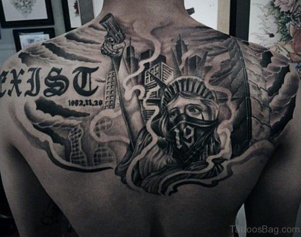 Gun And Mask Tattoo