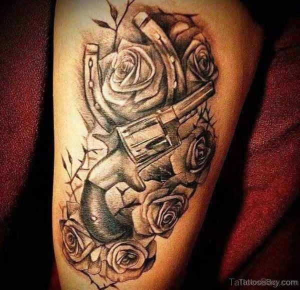 Gun And Rose Tattoo On Thigh