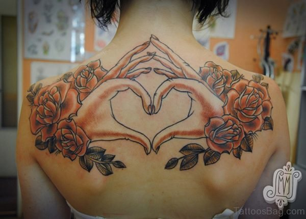 Hand Heart Tattoo On Upper Back