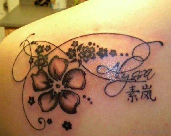 Hawaiian Flower Tattoo On Back