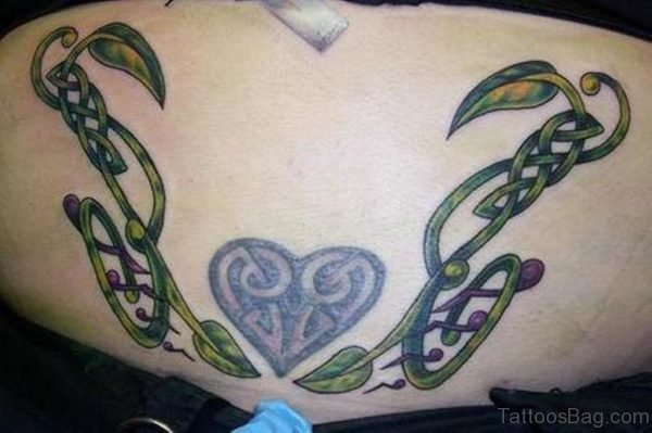 Heart And  Music Note Tattoo On Lower Back