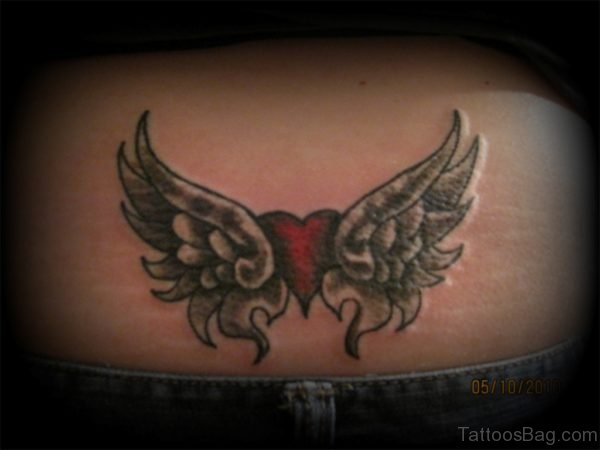Heart With Wings Tattoo On Lower Back