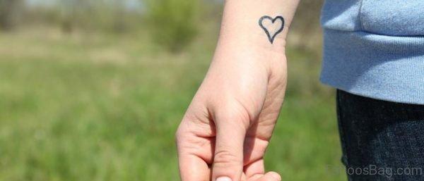 Heart Wrist Outline Tattoo