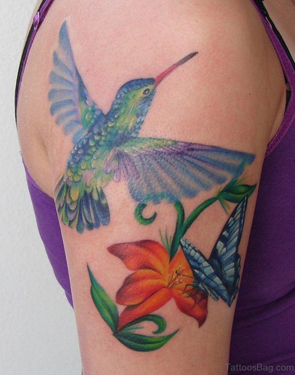 Hummingbird And Lily Tattoo On Shoulder