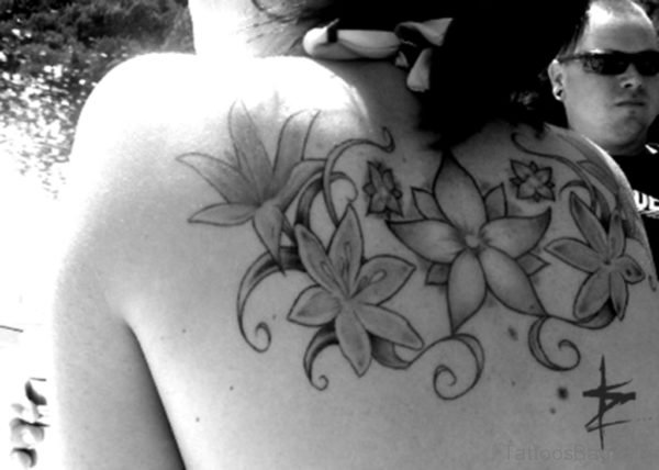 Impressive Lily Flower Tattoo On Back