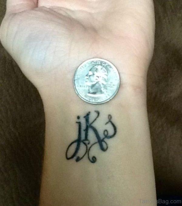 Initials Word Tattoo On Wrist