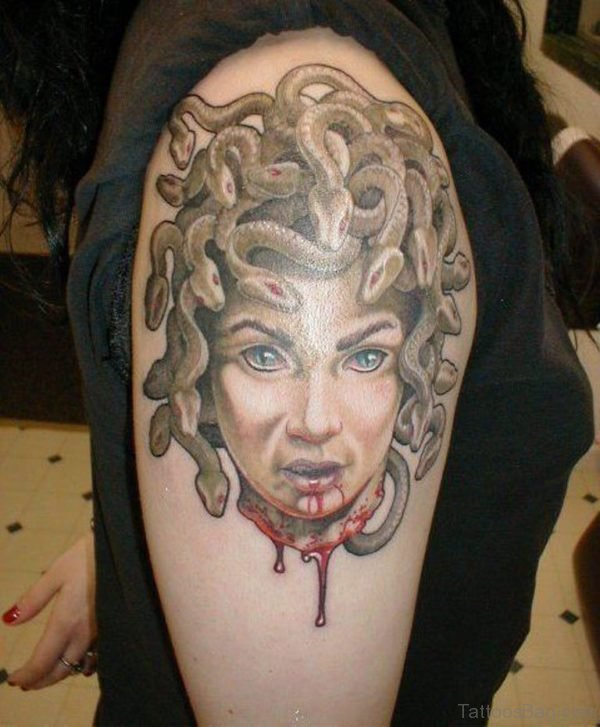 Injured Medusa Tattoo On Right Bicep