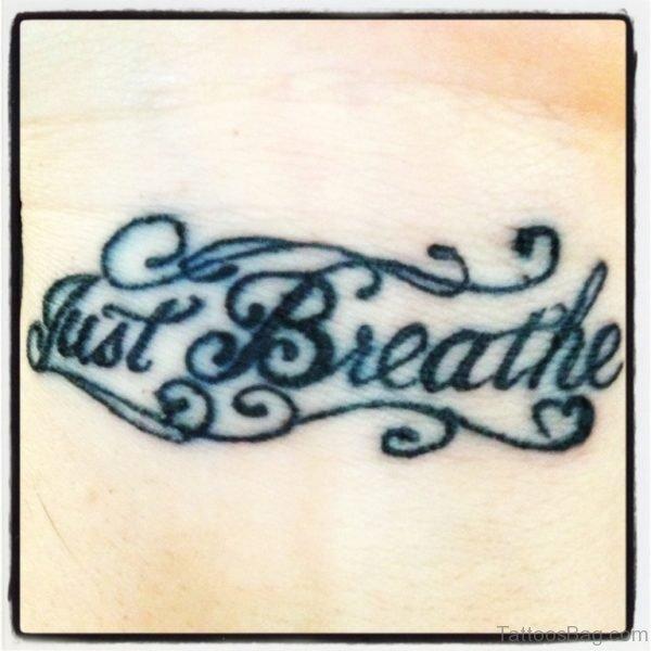 Just Breathe Tattoo On Wrist