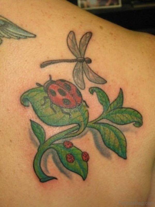 Ladybugs On Green Leaves Tattoo
