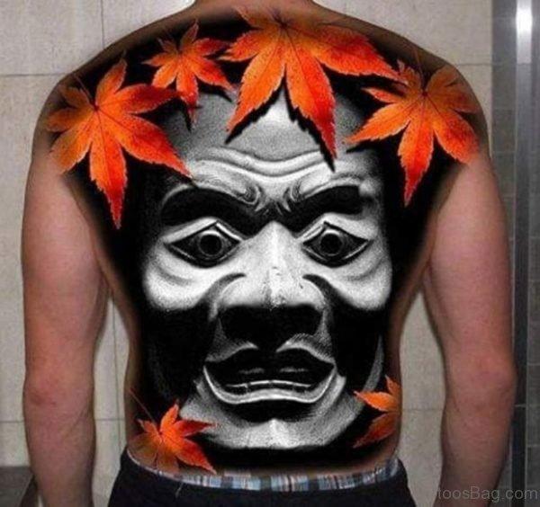 Leaf And Mask Tattoo