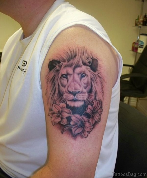 Lion And Flower Shoulder Tattoo