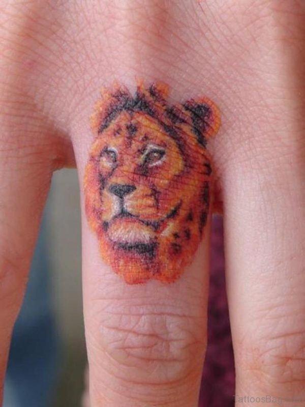 Lion Tattoo On knuckle