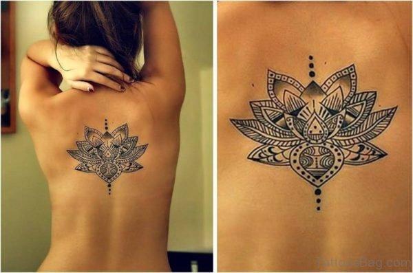 Lotus Flower Tattoo On Girl Upper Back
