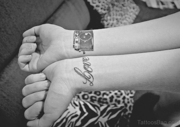 Love And Camera Tattoo On Wrist