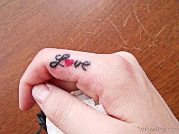 Love Word Tattoo On Finger