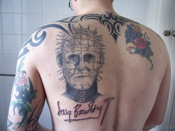 Man Face Tattoo On Back