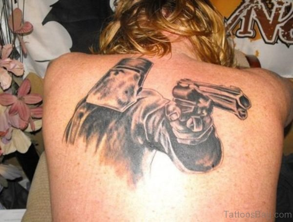 Mask Man With Gun Tattoo On Back