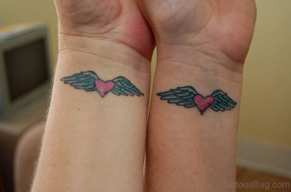 Matching Heart With Wings Tattoo