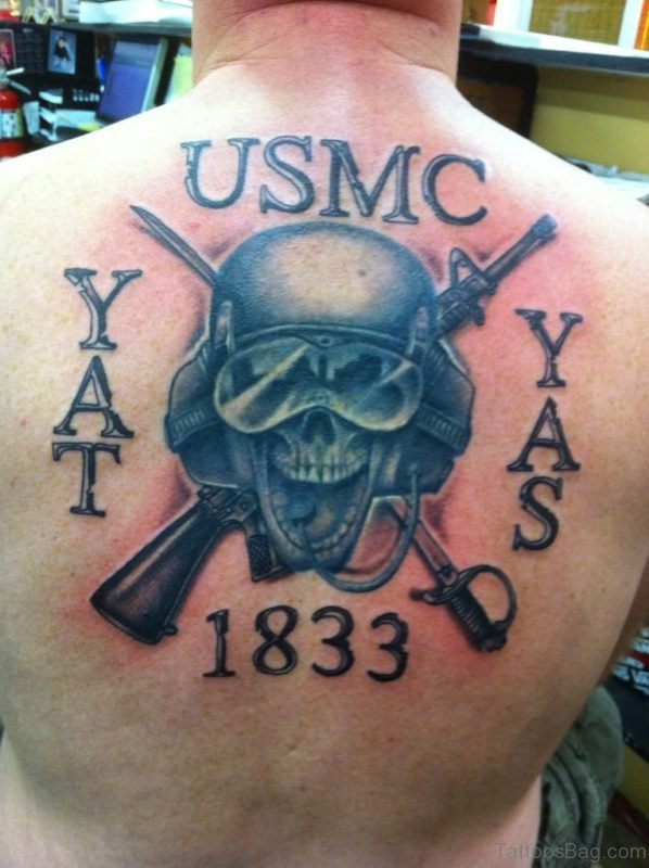 Memorial Marine Skull With Two Crossing Gun Tattoo On Man Upper Back