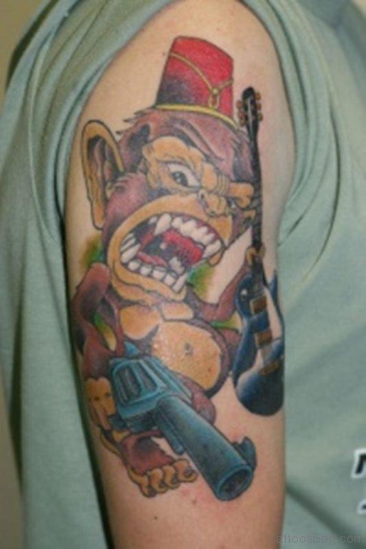 Monkey Holding Gun Tattoo On Shoulder
