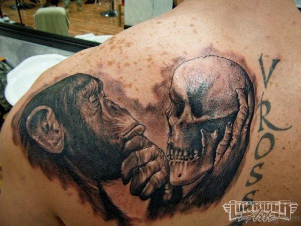 Monkey Holding Skull Shoulder Tattoo