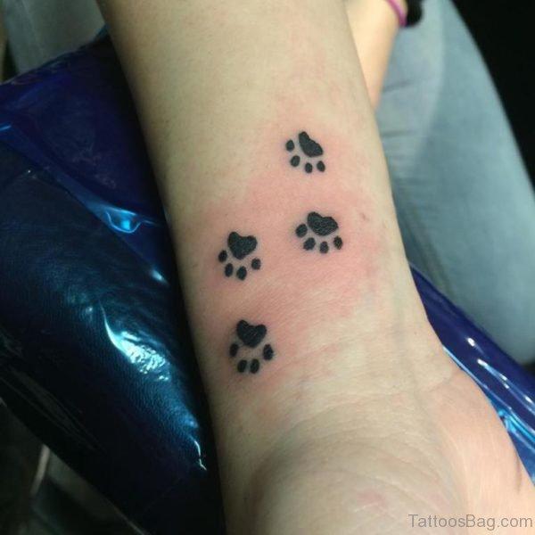 Multiple Paw Tattoo On Wrist