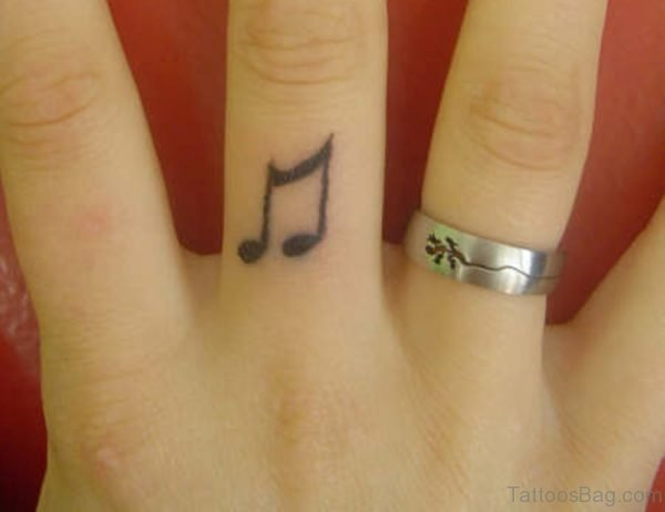Music Note Finger Tattoo