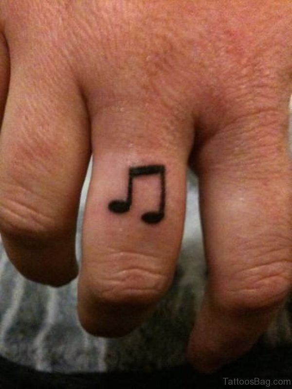 Music Notes Tattoo On Fingers