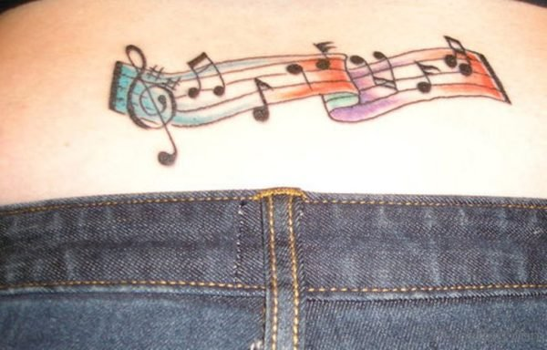 Music Notes Tattoo On Lower Back