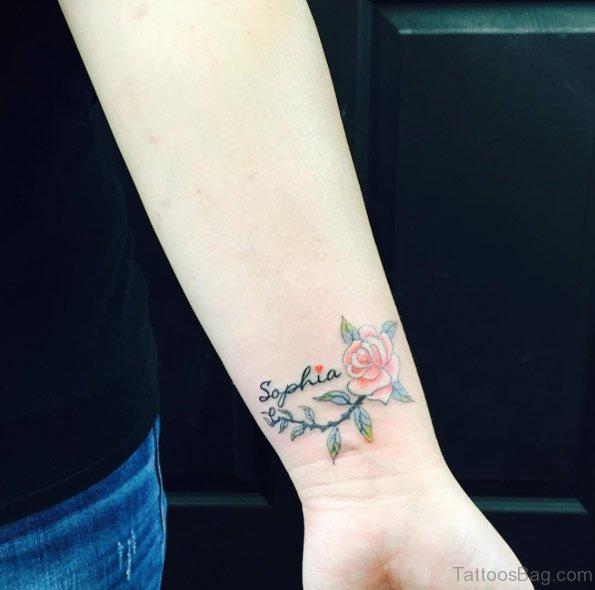 Name And Rose Tattoo On Wrist