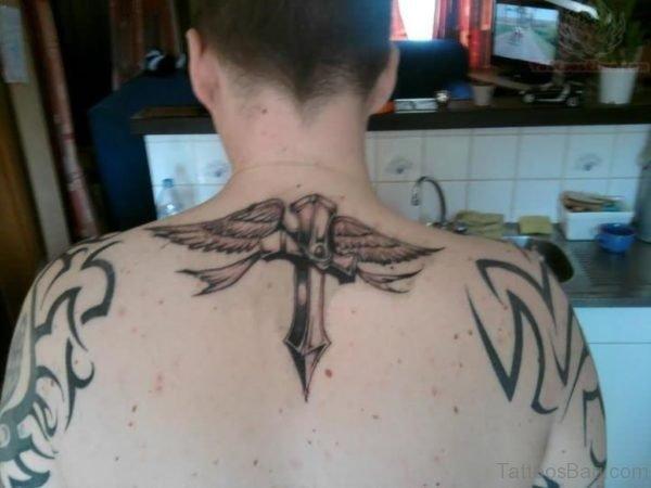 Nice Cross And Wings Tattoo