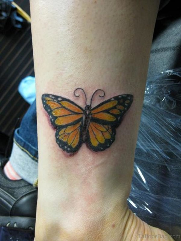 Nice Yellow Butterfly Tattoo On Wrist