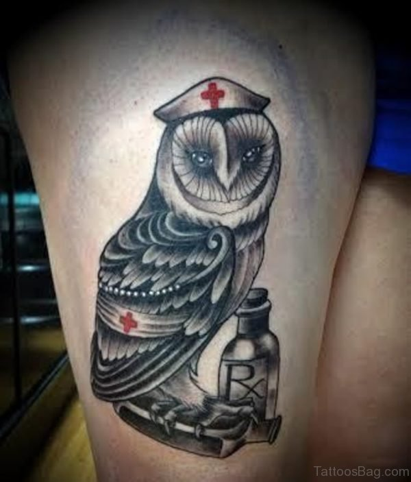 Nurse Hat On Owl Head Tattoo On Thigh
